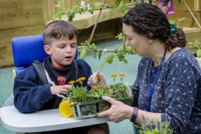 Learning activities at the Royal Blind School are customised for children with visual impairment, photo shows young box in the garden