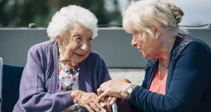 Female resident chats with a friend at Braeside House