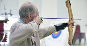 Veteran with sight loss shoots arrow at archery target
