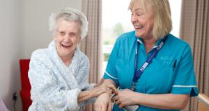 Jenny's Well resident walks with a nurse