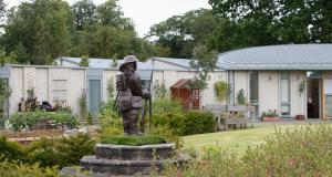Linburn Centre's garden with Tommy statue