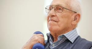 Veteran holds up dumbbell in strength and balance class at Linburn Centre