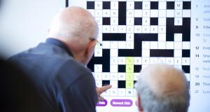 Two veterans work on large screen crossword in Linburn Centre IT suite