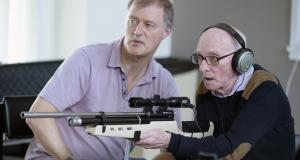 Centre officer supports veteran with sight loss to take part in acoustic shooting